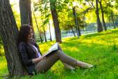 Girl sitting park read book — Stock Photo