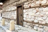 Stone wall wooden door — Stock Photo