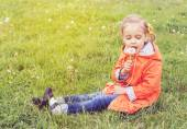 Girl on grass with dandelion — Stock Photo