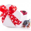 Gift box ribbon red heart with flower petals — Stock Photo #62999347