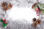 Tinsel frame background pine cone bow — Zdjęcie stockowe