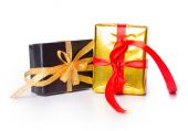 Two gift box bow red yellow black — Stock Photo