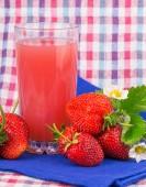 Strawberry juice in glass — Stock Photo