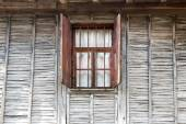 Wooden wall window — Stock Photo
