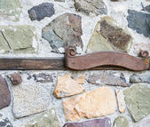 Wooden plaque on stone wall — Stock Photo