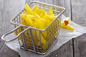 Homemade french fries in a frying basket — Stock Photo