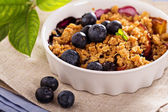 Peach and blueberry summer crumble — Stock Photo