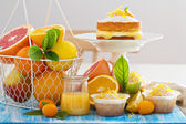 Citrus candy bar with fruits and cakes — Stock Photo