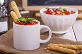 Tomato soup garnished with baked tomatoes — Stock Photo