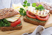 Sandwiches with pesto, vegetables and haloumi — Stock Photo