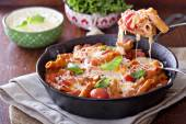 Pasta bake with penne, tomatoes and mozarella — Stock Photo