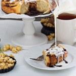 Cinnamon buns with chocolate and cream — Stock Photo #62744273