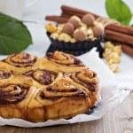 Cinnamon buns with chocolate and cream — Stock Photo #62745843