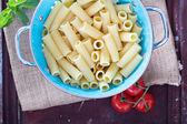 Cooked rigatoni pasta in a colander — Stock Photo
