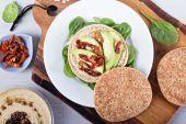 Vegan sandwich with hummus, avocado and tomatoes — Stock Photo