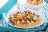 Polenta appetizers with ricotta and bacon — Stock Photo
