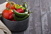 Green and red hot pepper on table — Stock Photo