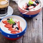 Yogurt bowl with blueberries and strawberries — Stock Photo #76027781