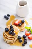 Stack of small pancakes with berries — Stock Photo