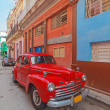 Vintage red car on the street of old city, Havana, Cuba — Stock Photo #55150809