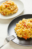 Risotto with red pepper, healthy vegan food — Stock Photo
