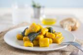 Delicious pumpkin gnocchi with sage leaves and olive oil, vegan  — Stock Photo
