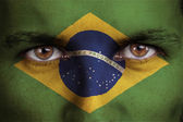 Brazil, brazilian flag painted on the face of young man — Stock Photo
