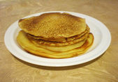 Plate with tasty pancakes — Stock Photo