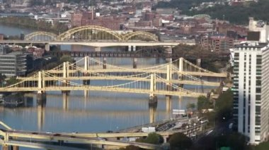 A zoom out from the Three Sister's Bridges to the Pittsburgh skyline.  In 4K UltraHD — Stock Video