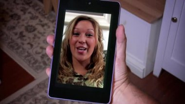 A woman videochats on a tablet PC.  In 4K UltraHD. — Stock Video
