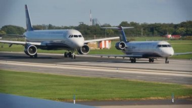 USAirways jetliners line up and wait for takeoff. — Stock Video