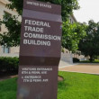 A daytime establishing shot of the Federal Trade Commission Building in Washington, D.C. — Stock Video #78573112