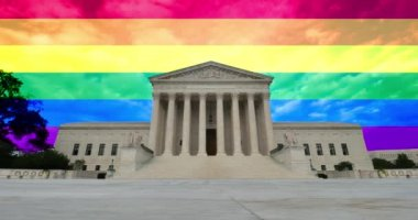 A time lapse view of the grand entrance of the Supreme Court with the rainbow flag above and behind. — Stock Video