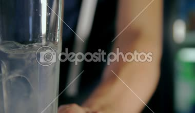 Bartender pouring two glasses of ice and syrup with tonic. Dolly shot. — Stock Video
