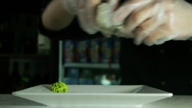 Cook serving japanese sushi rolls on a plate — Stock Video