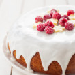 Banana Cake with Sugar Glaze Topped with Raspberries and Banana  — Zdjęcie stockowe #68069979