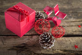 Christmas present on wooden background — Stock Photo