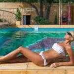 Woman relaxing near swimming pool — Stock Photo #59571309