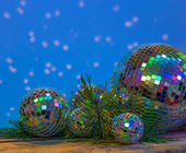 Christmas Mirror balls on wooden background — Stock Photo