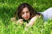Woman having rest on meadow — Stock Photo