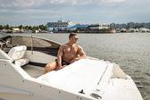 Muscle man on a boat — Stok fotoğraf