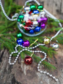 Colorful Christmas balls on wooden background — Stock Photo