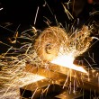 Sharpening and cutting of iron by abrasive disk — Stock Photo #64783819