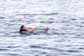 Woman study riding on a wakeboard — Stockfoto