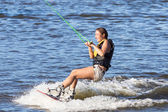 Woman study riding on a wakeboard — Stock Photo