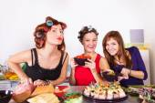 Three beautiful young women housewifes cook together — Stock Photo