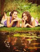 Two beautiful young brunet woman outdoors — Stock Photo