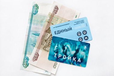 Electronic payment card Troyka for transport and banknotes.Russia.Moscow.February,6,2015.
