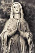 Vintage sepia image of Holy Virgin Mary Catholic Church Mother of God religious woman praying — Stock Photo