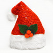 Single shimmering Santa Claus red hat with mistletoe isolated on white background — Stock Photo #59843541